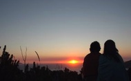 Couple watching Peaceful Sunset on a Romantic Getaway Vacation